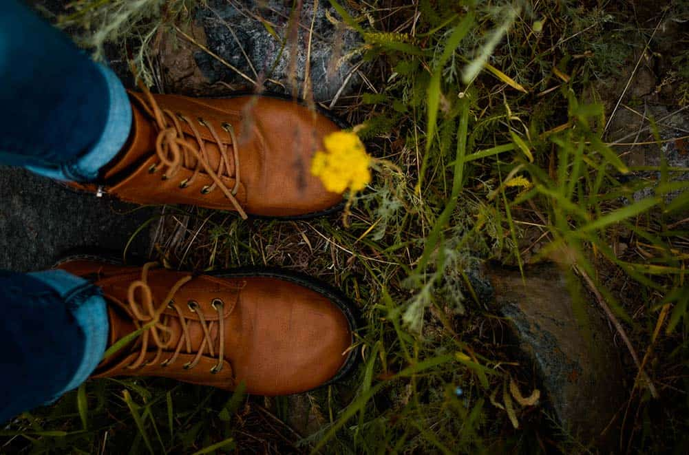 Self-portrait of a persons feet in nature.